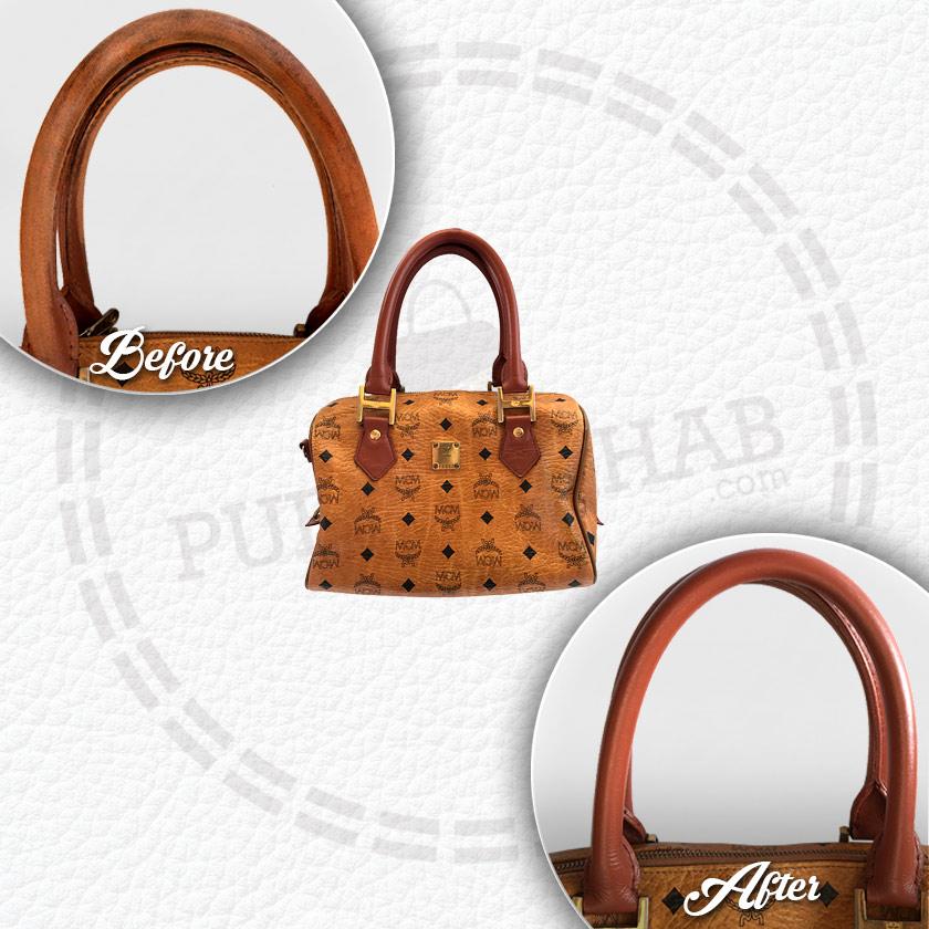 Worn handles on MCM bag